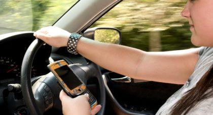 Brownhair teenage girl driving car